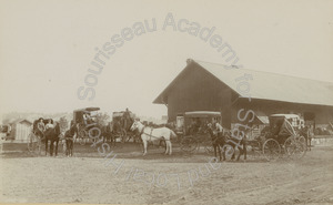 Image of Warehouse with horse and buggies in front